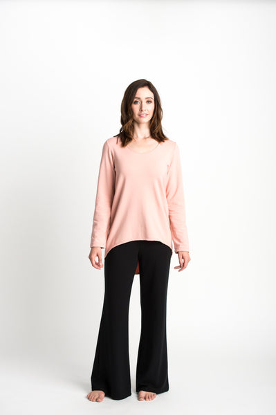 The Linda Pant has a wide waistband and a flared leg and is made from sustainable fabrics.