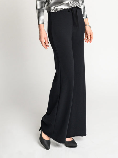 The Cozy Pant with a long, wide-leg with a raw bottom hem and 2 inch elastic waistband and drawstring.