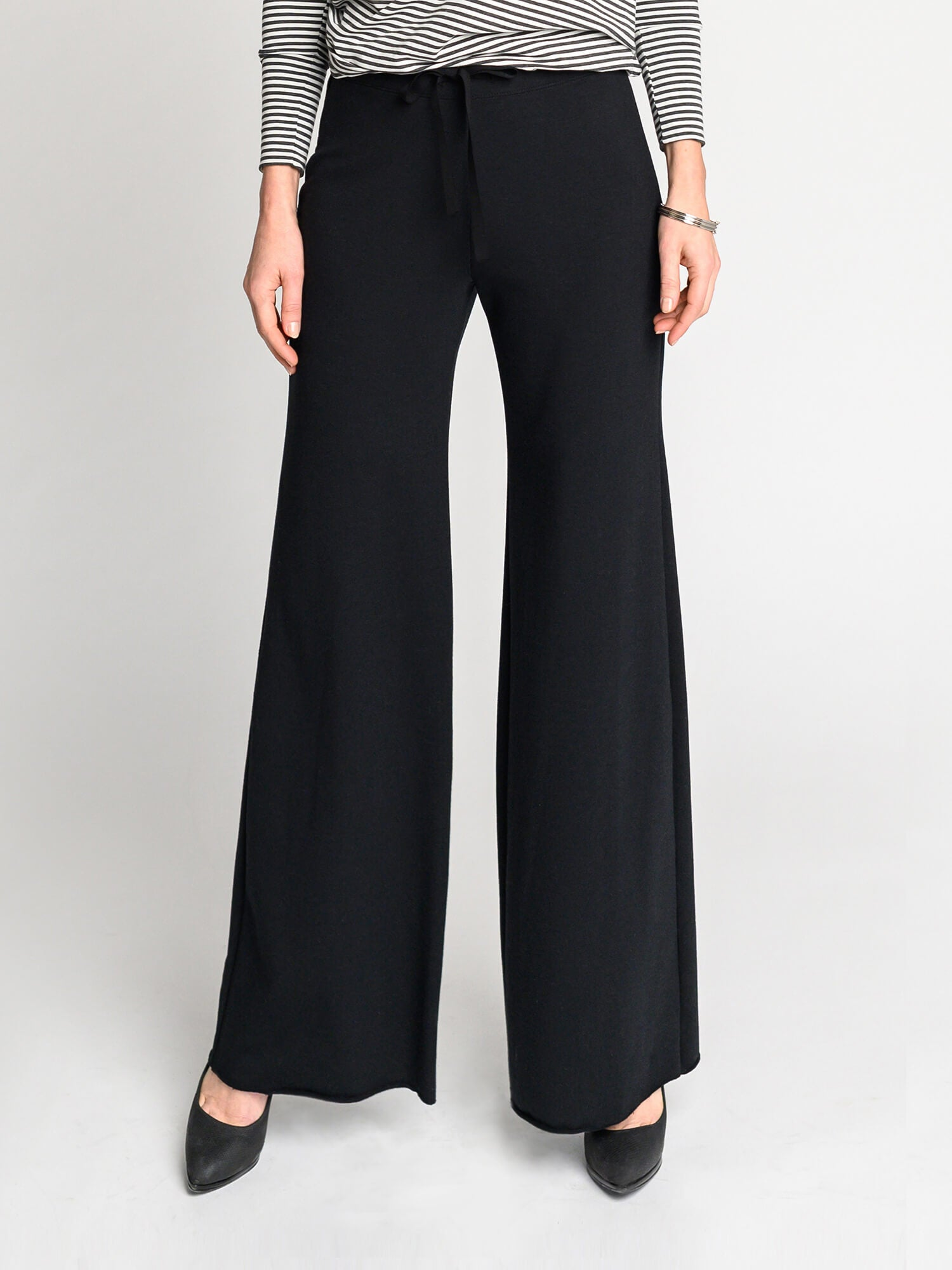 Black wide-leg pant with 2 inch elastic waistband and raw bottom hem.