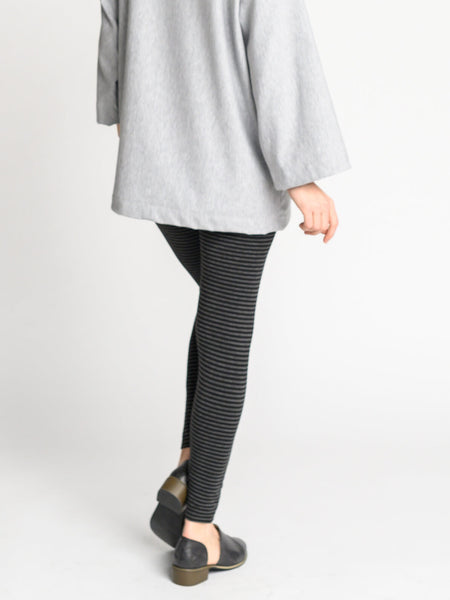 Back view of the black and heather grey striped leggings with a wide waistband and fitted legs.
