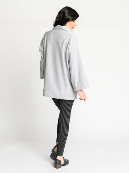 Back of the Sierra Sweater in a heather grey plush bamboo fleece fabric and loose collar.