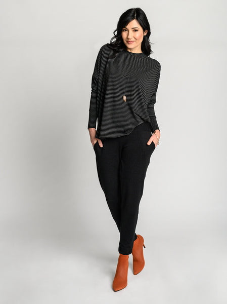 Black and dark grey striped comfy top with high side seam and neckline for a relaxed feel.