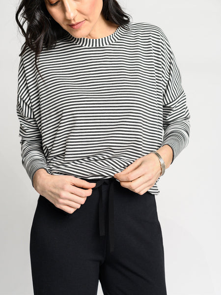 White and heather grey striped top with high scoop neckline and fitted sleeves with thumb holes.