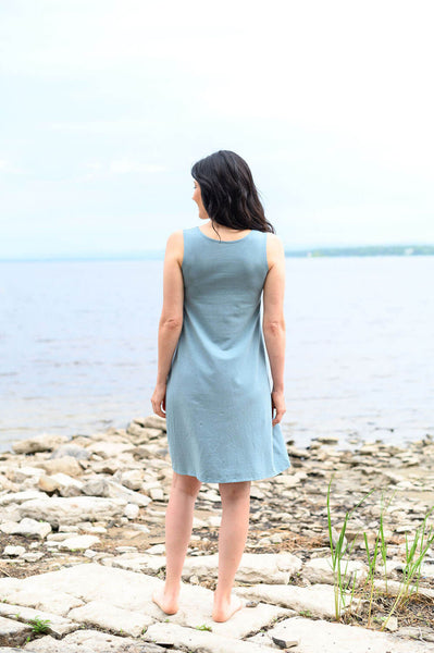 Basic tank dress with a reversible boatneck or v-neckline with a knee length loose fitting skirt.