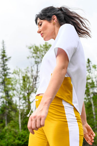 Comfortable athletic pant in mango with a white stripe and white drawstring detail.