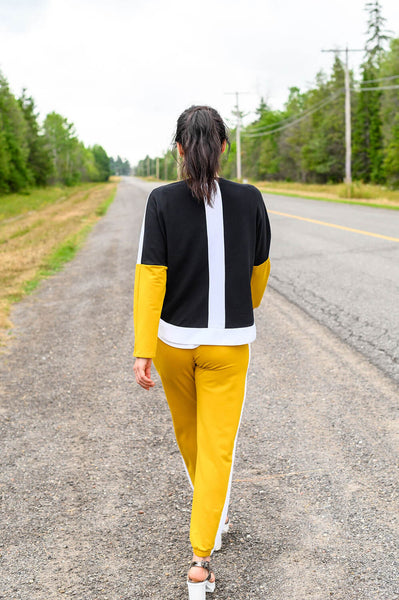 Relaxed fit, long sleeve sweater made from yellow, black, and white sustainable, bamboo fabric.