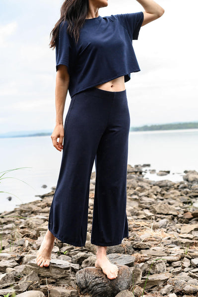 Flat front waist details and wide leg on the cropped navy blue pant.