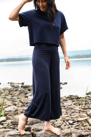The Lantern Pant has a wide leg and flat-fronted waist and is made from eco-friendly fabric.