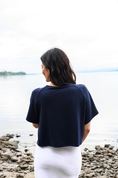 Navy blue cropped shirt with a raglan style sleeve made from eco-friendly fabric.