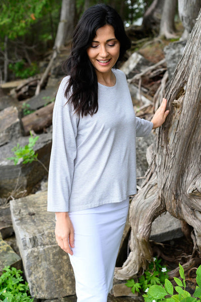 Light sweater with a drop shoulder made from light grey and white striped bamboo organic cotton.