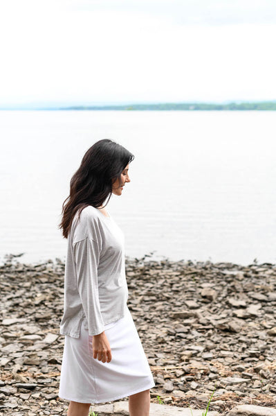 The Soma Top is a light grey and white striped sweater with a drop shoulder and draped shape made from eco friendly, organic bamboo cotton.