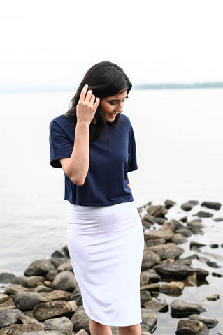 The Travelers Skirt is a white, H-line skirt made from sustainable, eco-friendly fabrics.