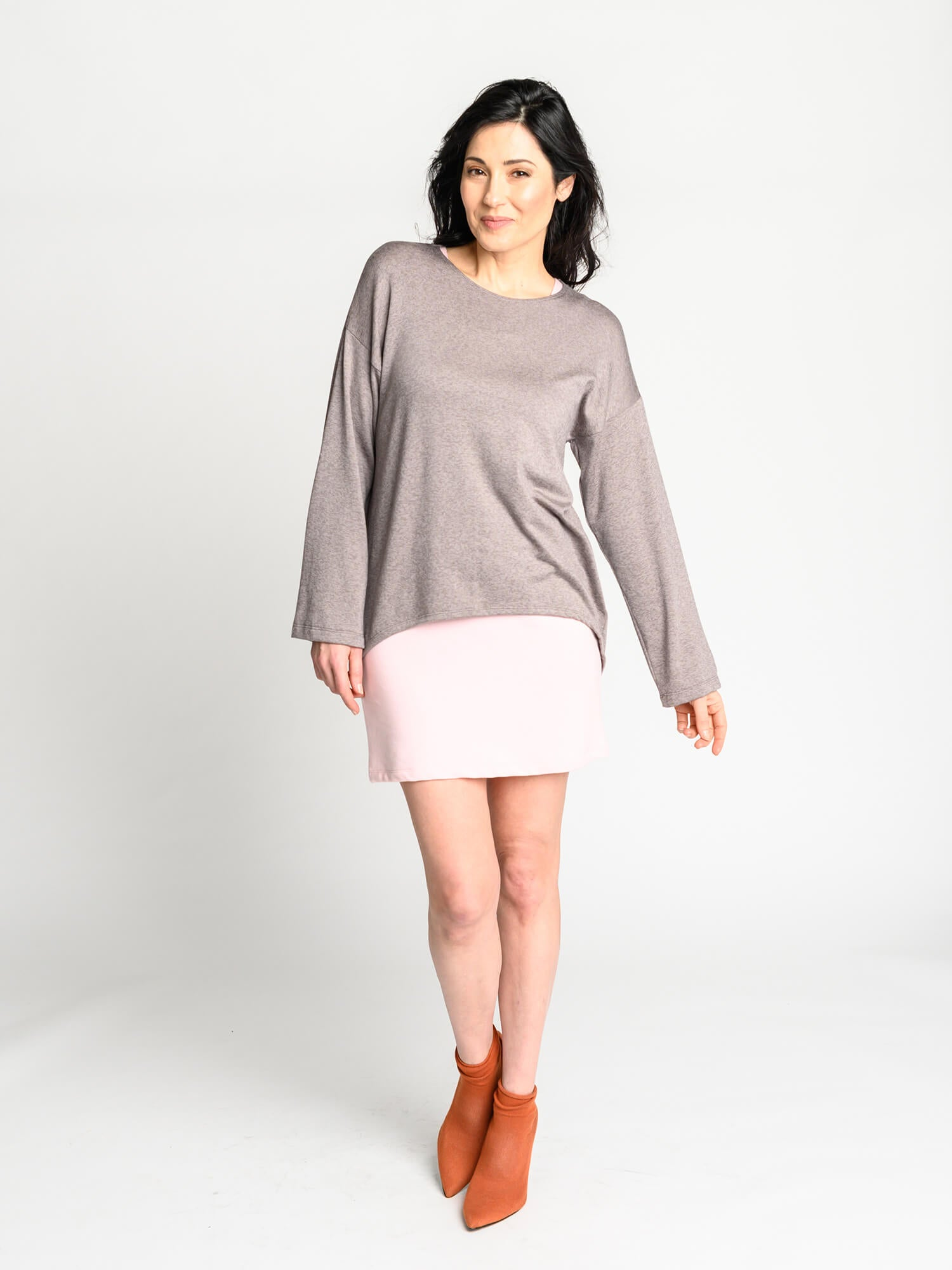 The Crescent Sweater in mink with scooped, high-low hemline and drop shoulder detail.