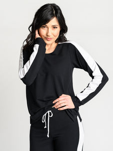 The Endurance Top is made of black bamboo cotton stretch french terry with a white sport stripe on the arm and vent at the side seam.