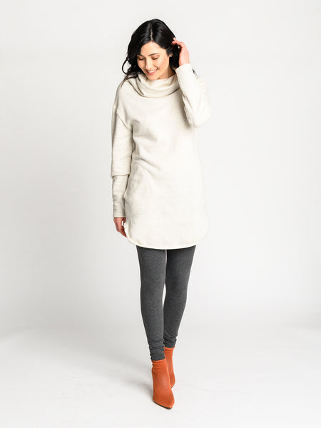 Long sweater with cowl neckline and shaped hem in an oatlmeal herringbone terry fabric.