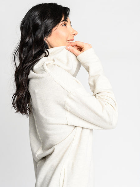 Cowl neckline and exposed seam details on the Le Hibou Sweater.