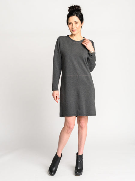 The Mod Dress in dark grey with pink stitching and a scooped neckline.