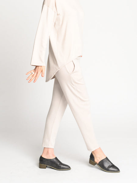 Side view of the white jogger pant that can transition from work to evening wear.