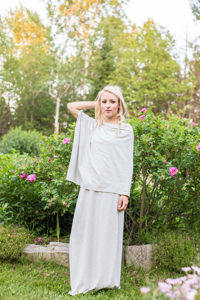 A lightweight shawl made from light grey, sustainable bamboo fabric is the perfect summer capsule wardrobe staple.