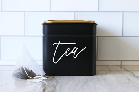 calligraphy black tea or coffee tin canister