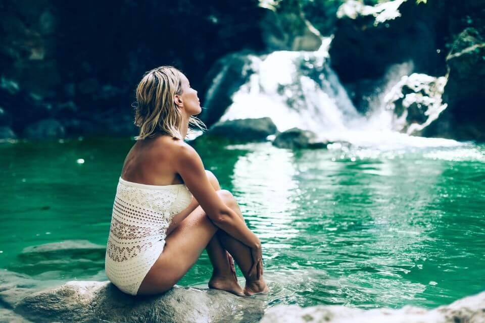 Image of Woman viewing tranquil pool.