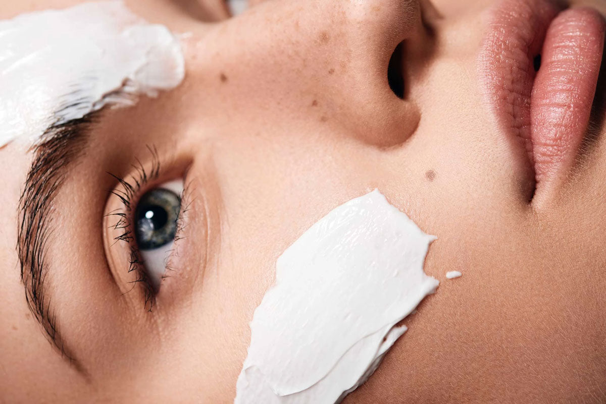 image of close up of face with skin creams on it