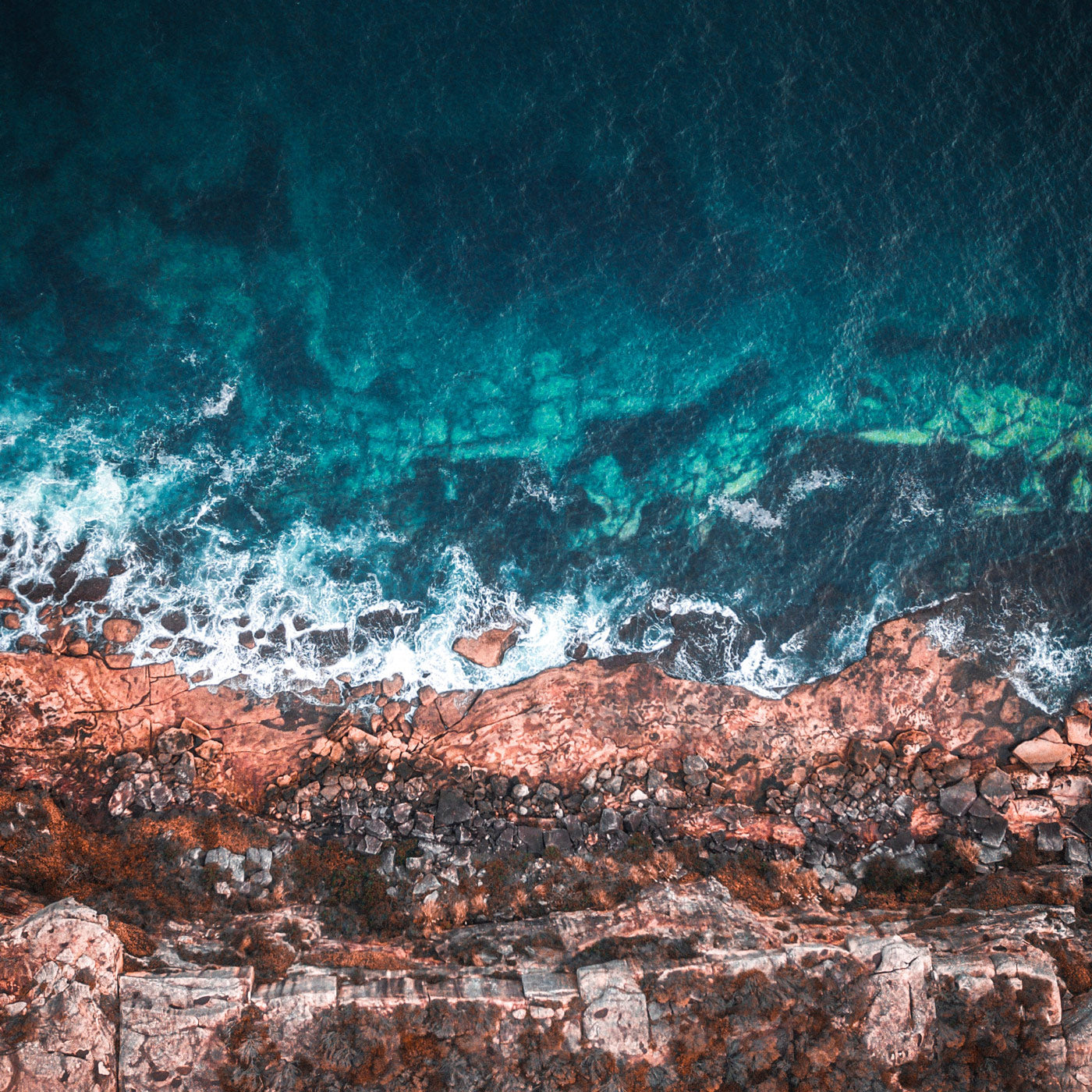 image of rocky beach cliff above ocean shore