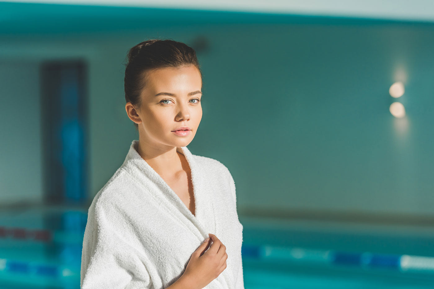 image of woman in bathrobe at the pool