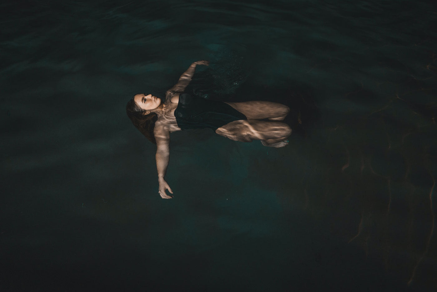 image woman floating in water