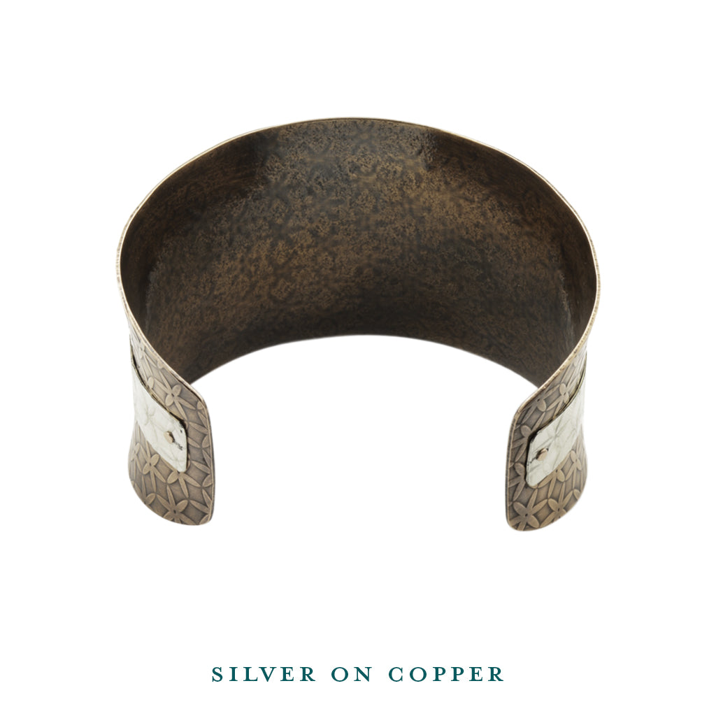 Silver on copper anticlastic cuff bracelet inside
