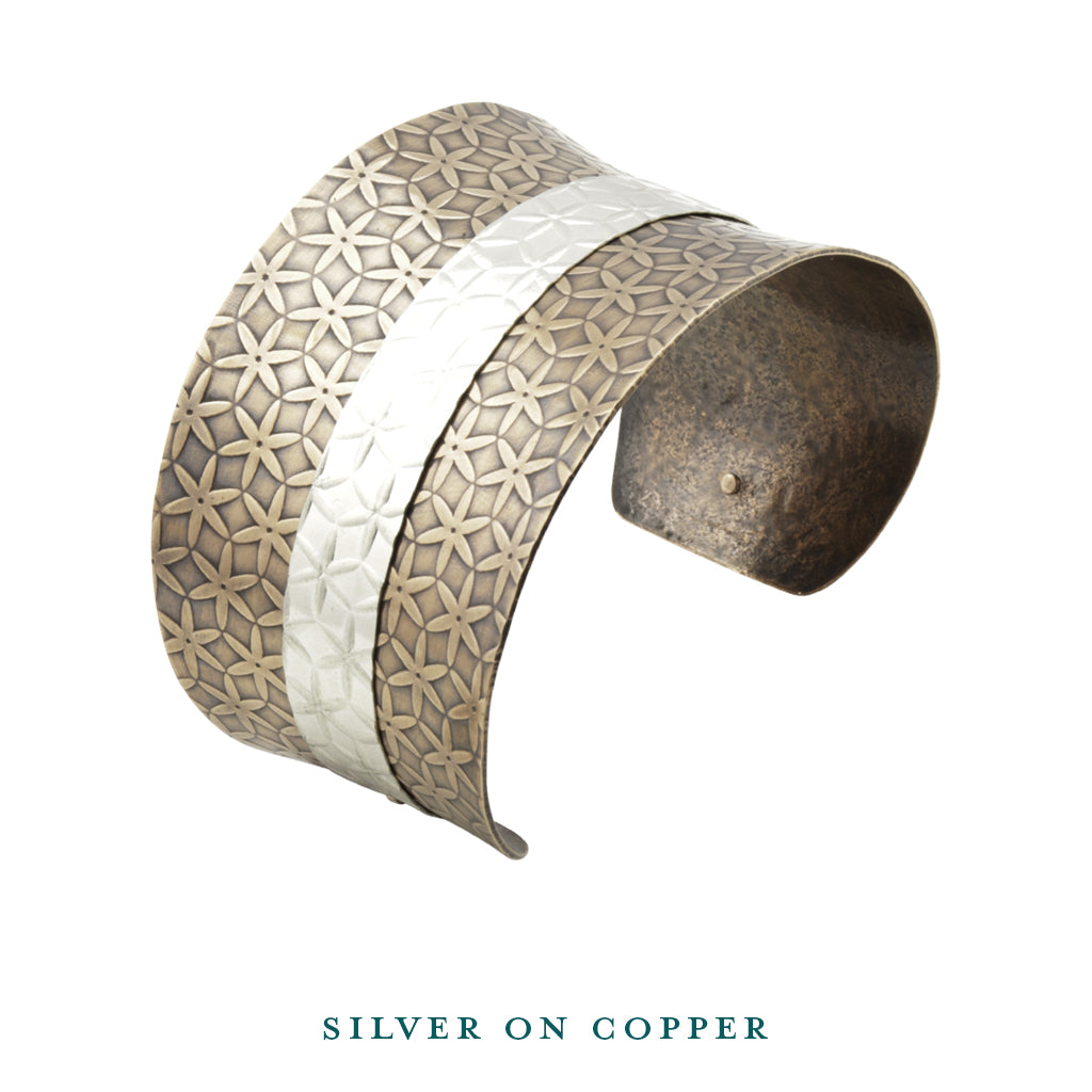 Silver on copper anticlastic cuff bracelet top