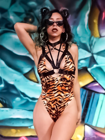 tiger print bodysuit for a tiger rave or festival halloween costume. Paired with kritter klips