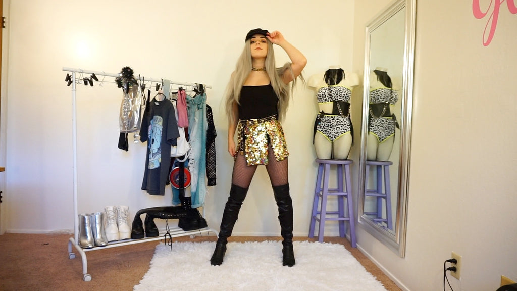 Gold sequin loin cloth skirt layered over black bodysuit for a festival outfit