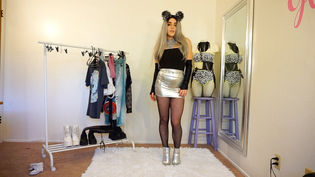 silver new years rave outfit with puff ball kitty ears and silver booties and black arm sleeves