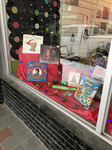 Christmas albums in a window