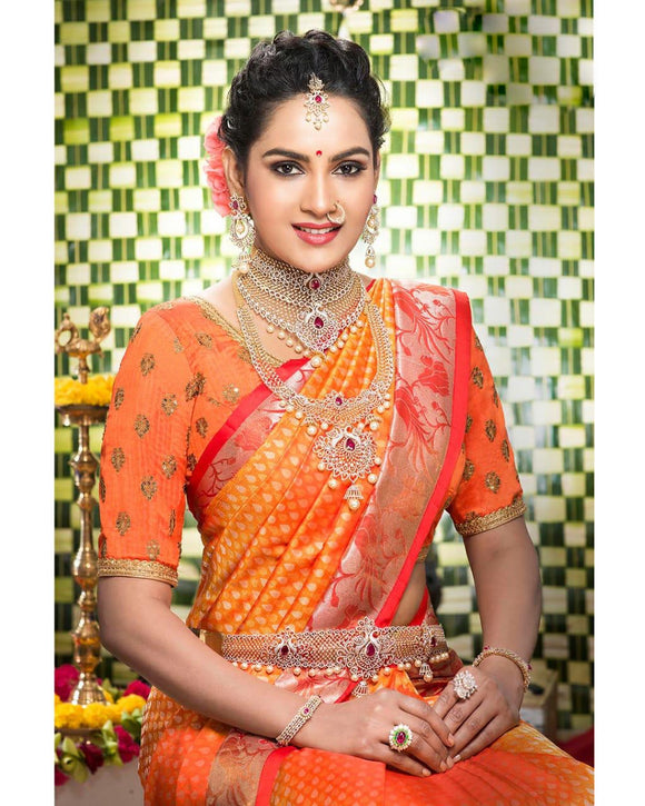 Orange colour kanchipuram silk saree with silver zari weaving in the border