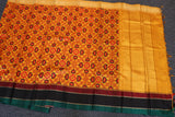 Yellow colour dupion silk saree with ikkat design