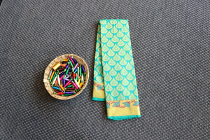 Mint green dharmavaram silk saree with traditional weaving