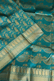 Mint green kanchipuram saree with traditional mango design