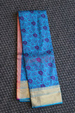 Blue colour kanchipuram saree with self embose weaving with floral design