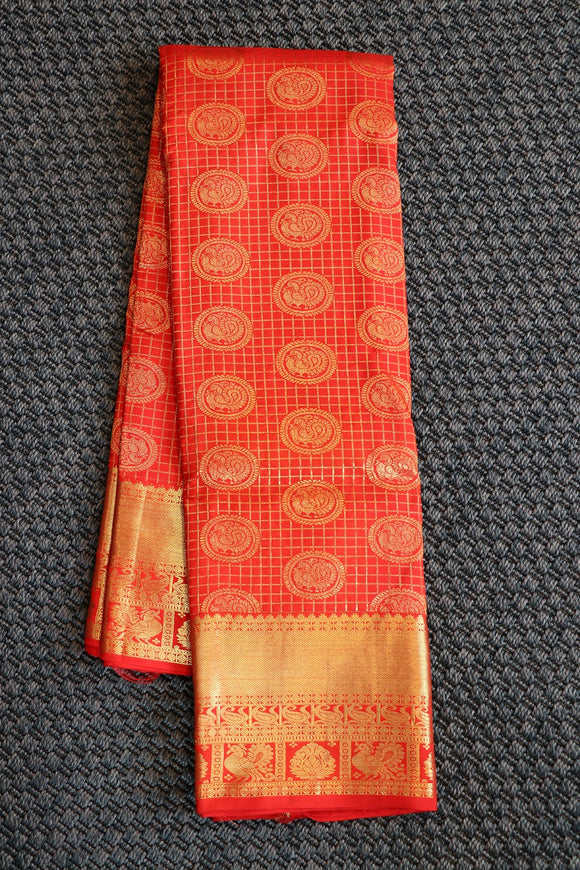 Tomato red kanchipuram silk saree with traditional peacock design