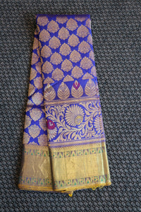 Blue colour kanchipuram silk saree with parrot green border and pallu