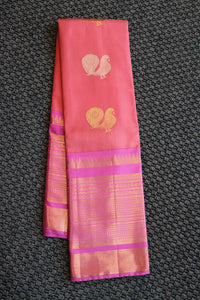 Peach colour designer kanchipuram saree with gold and silver peacock design