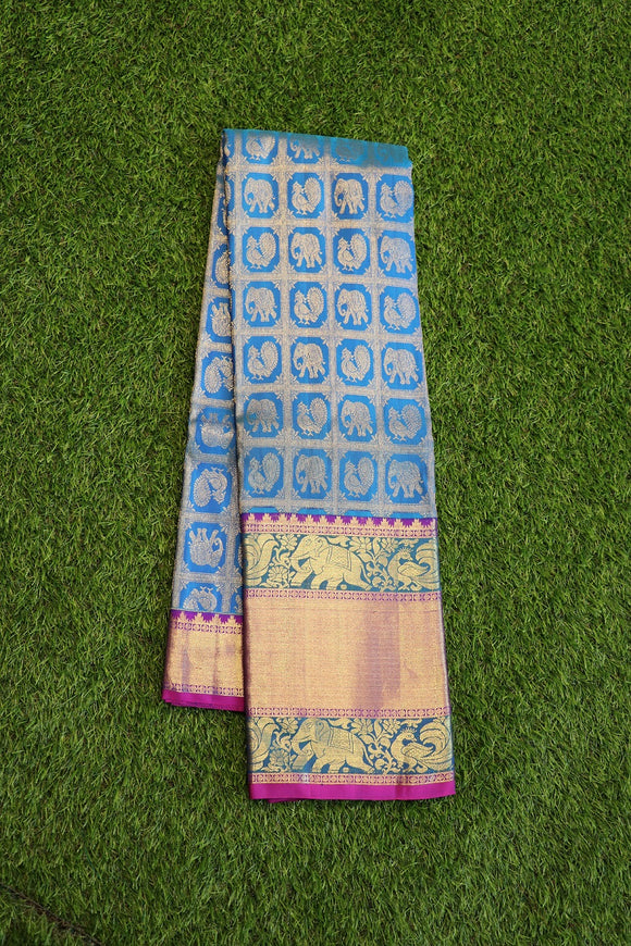 Blue colour kanchipuram silk saree with big pink colour border