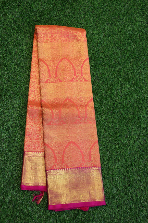 Peach colour kanchipuram silk saree with traditional design