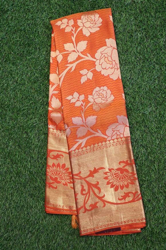 Orange colour kanchipuram silk saree with beautiful floral design
