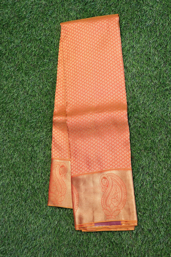 Carrot orange colour kanchipuram silk saree with traditional small motifs