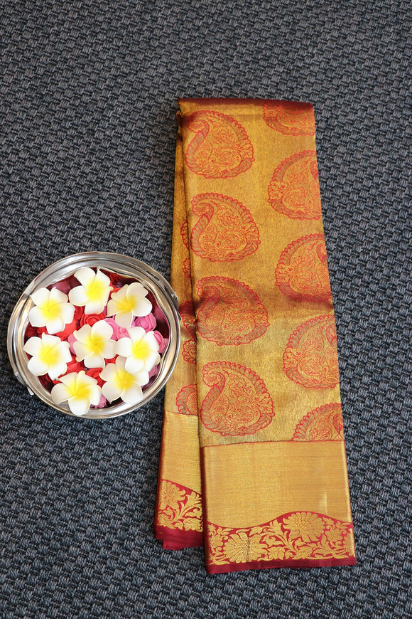 Maroon colour traditional kanchipuram silk saree with self colour pallu and border