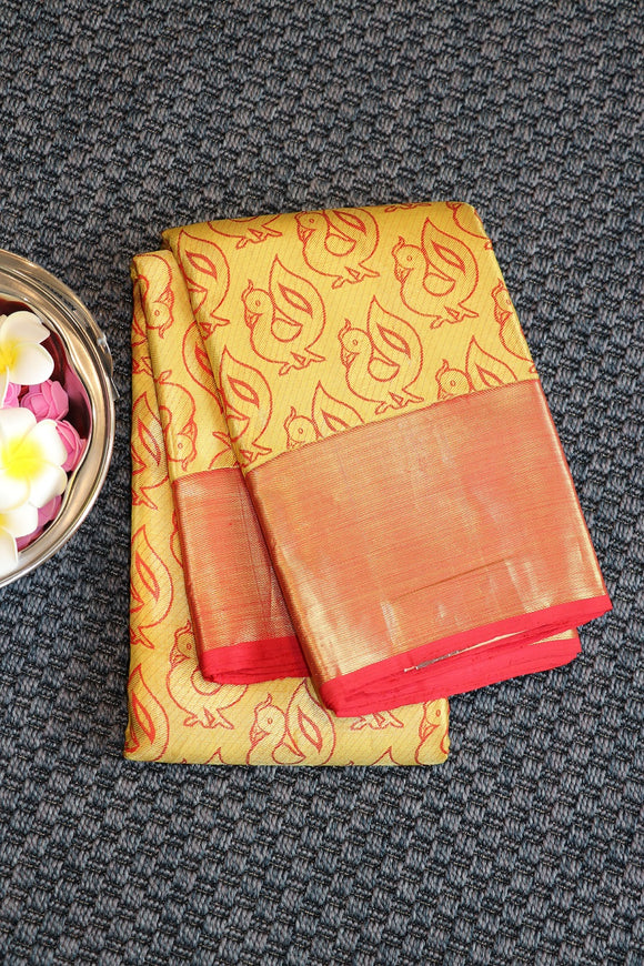 Yellow colour kanchipuram tissue saree with red colour border and designer pallu