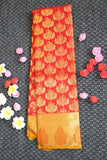 Tomato red kanchipuram silk saree with traditional mango design